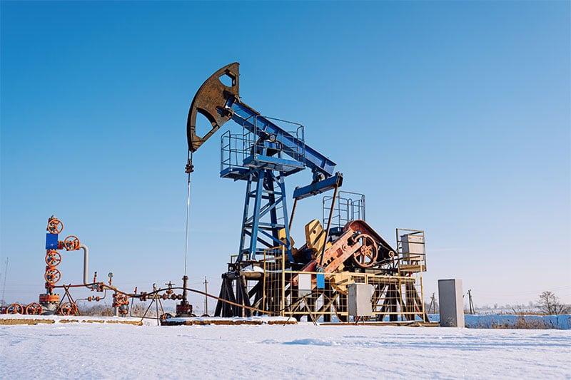 oil pump in winter sunny day
